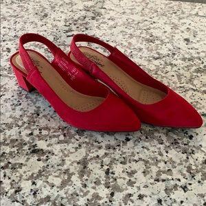 Red kitten heels.